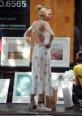 Portia Doubleday wears a white summer dress while shopping for artwork in SoHo, New York City