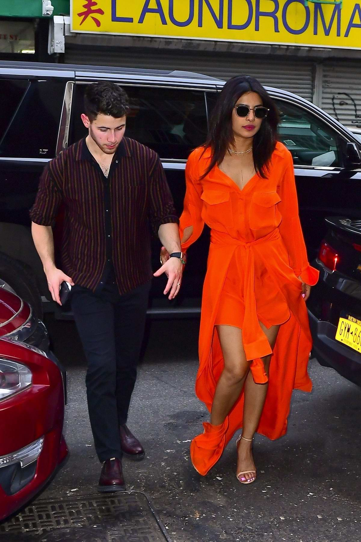 Priyanka Chopra looks vibrant in bright orange as she steps out with husband Nick Jonas in New York City