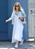 Rachel McAdams seen wearing a white summer dress during a coffee run in Los Angeles