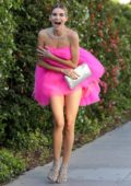 Rachel McCord looks striking in a pink mini dress as she heads for an event in Santa Monica, California