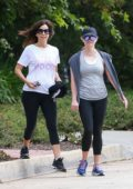 Reese Witherspoon heads for a workout with a friend in Los Angeles