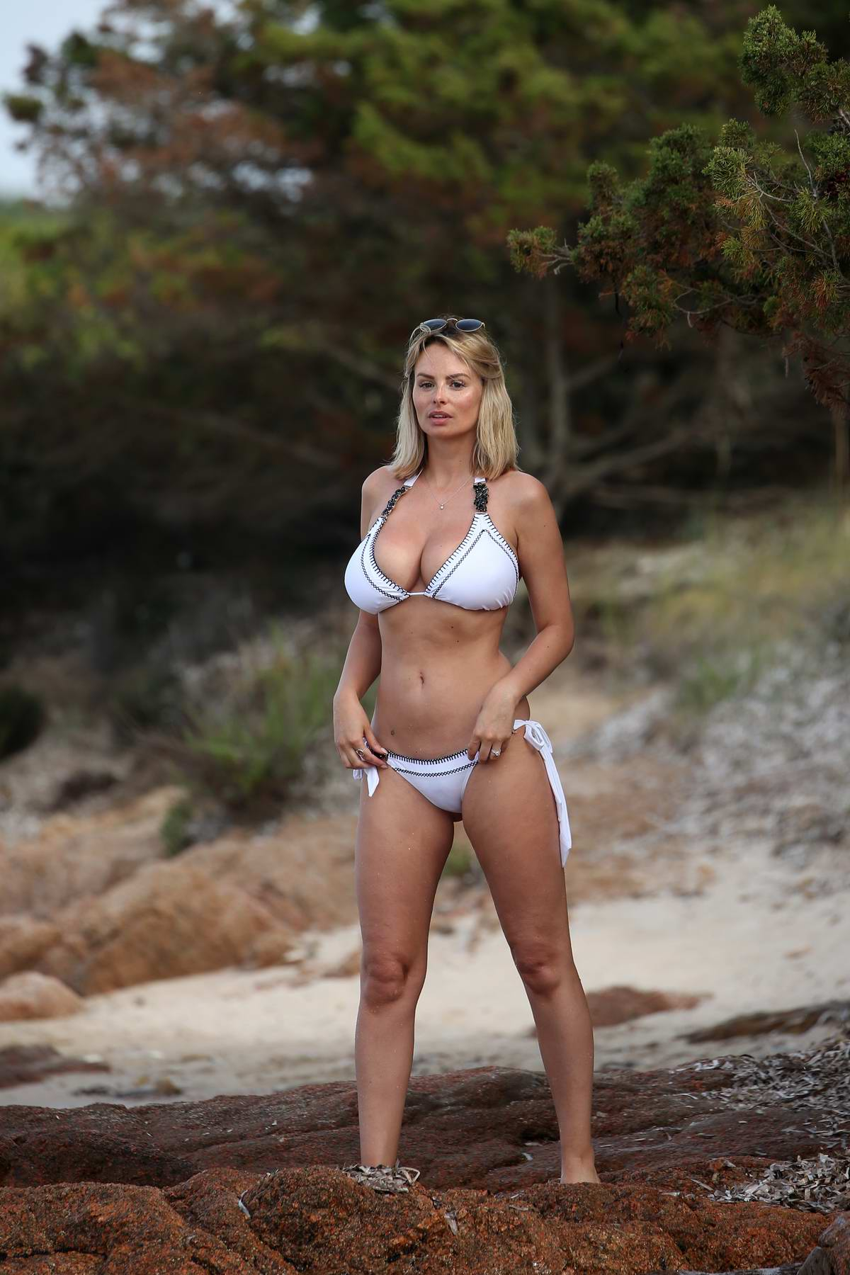 Rhian Sugden seen wearing a white bikini while at the beach in Porto Cervo, Italy