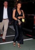 Rihanna looks stunning in a silky black dress as she heads for a private party in New York City