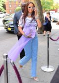 Rihanna smiles for the camera arrives to her goddaughter Majesty's 5th birthday Party in New York City