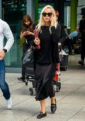 Rita Ora dons all-black as she touches down at Heathrow Airport in London, UK