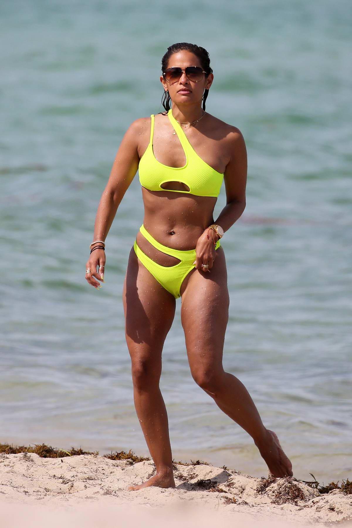 Rocsi Diaz stuns in a neon green bikini as she enjoys a day at the beach in Miami, Florida