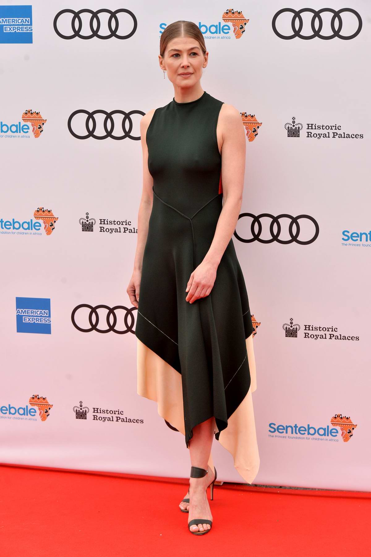 Rosamund Pike attends the Audi Sentebale Concert 2019 at Hampton Court Palace in London, UK