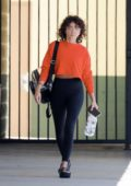Sarah Hyland wears an orange cropped top and black leggings while seen leaving IdentoGo in Burbank, California