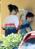 Selena Gomez helps an elderly woman while leaving a dermatologist office in Los Angeles