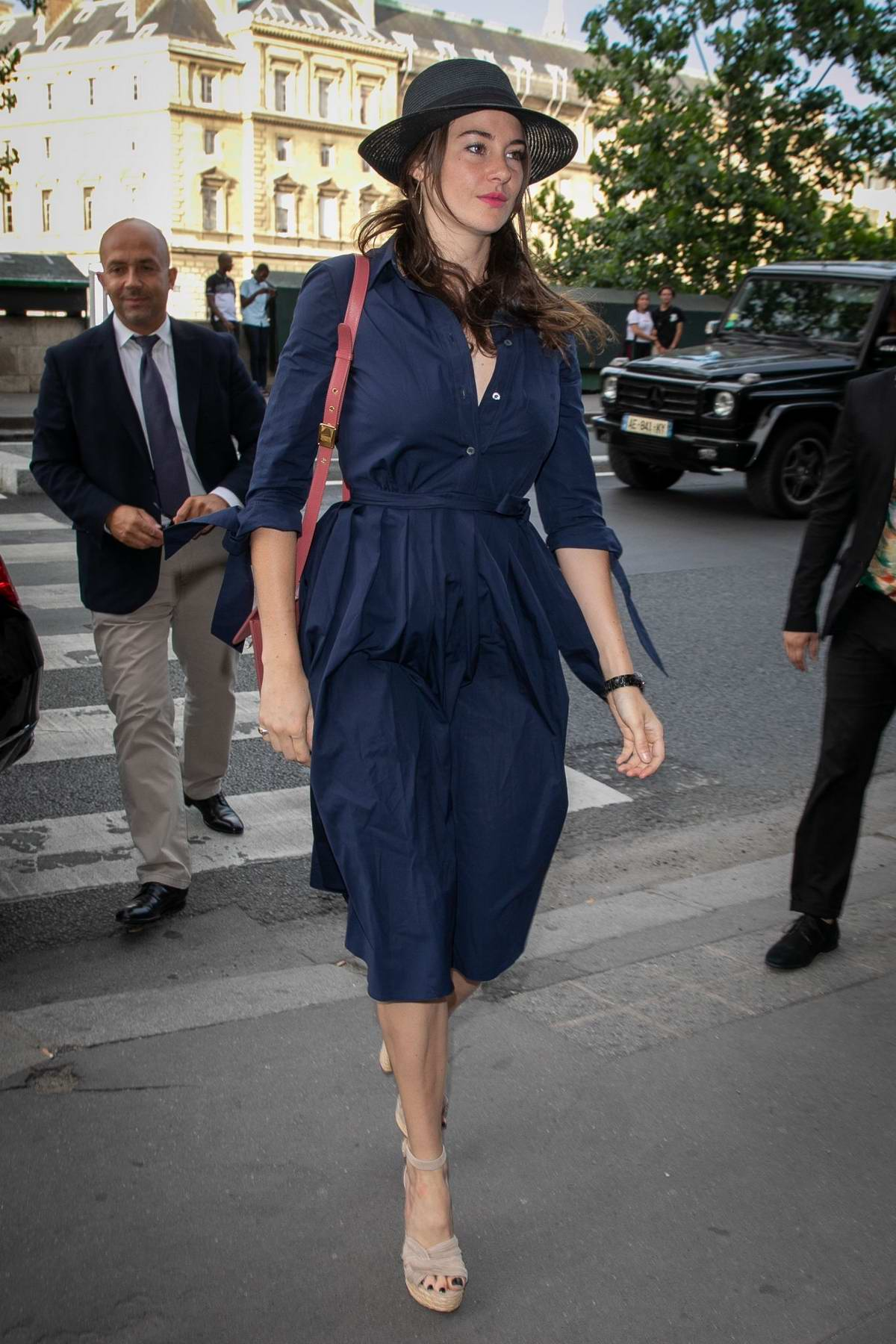 Shailene Woodley looks chic in a navy blue dress as she arrives at the Laperouse restaurant in Paris, France