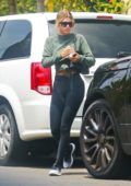 Sofia Richie bares her midriff in crop top and leggings as she leaves a friend's house in Los Angeles