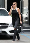Sofia Richie wears a black tank top and ripped jeans for a shopping trip to XIV Karats in Beverly Hills, Los Angeles