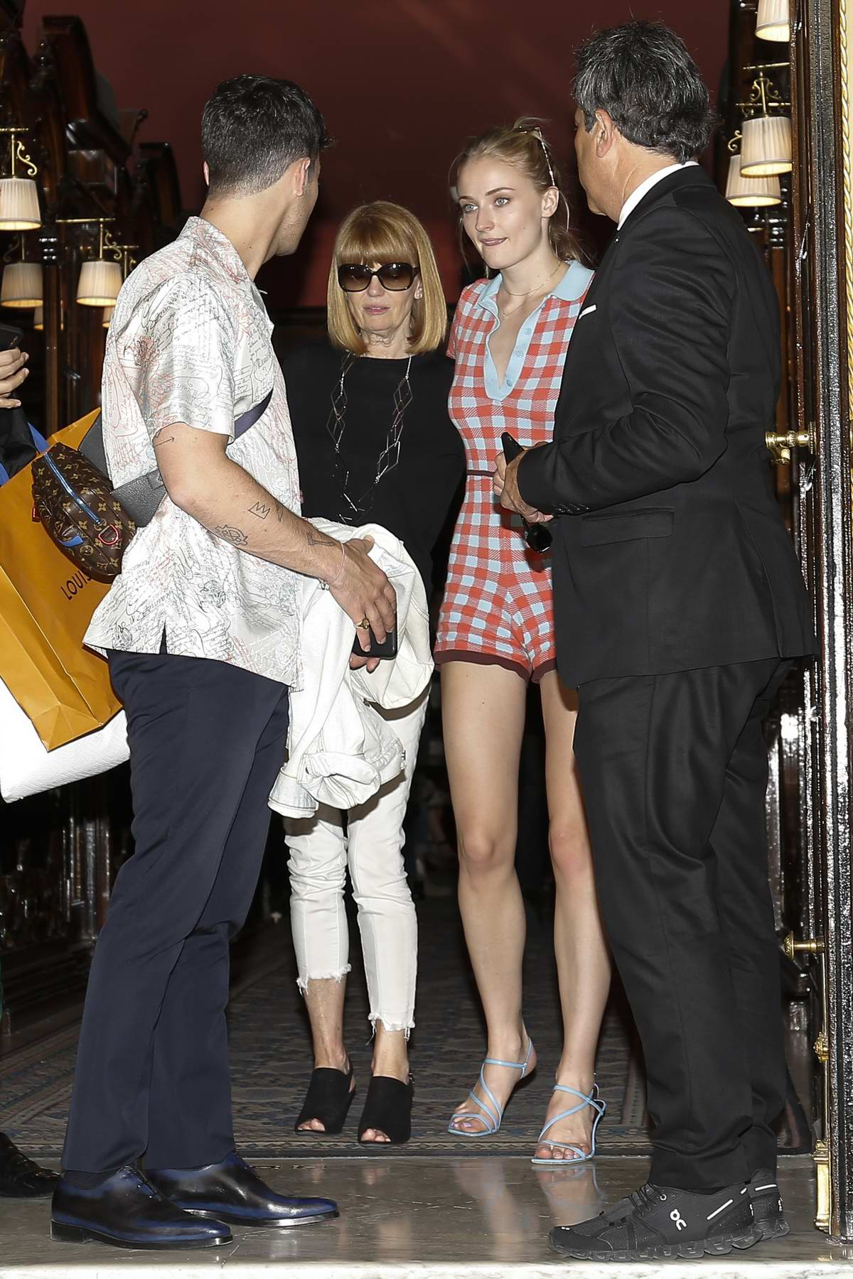 Sophie Turner seen leaving The Costes Hotel with her mother and Joe Jonas during Paris Fashion Week in Paris, France