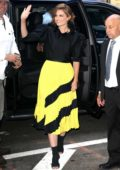 Stana Katic stands out in yellow and black as she arrives at Good Morning America in New York City