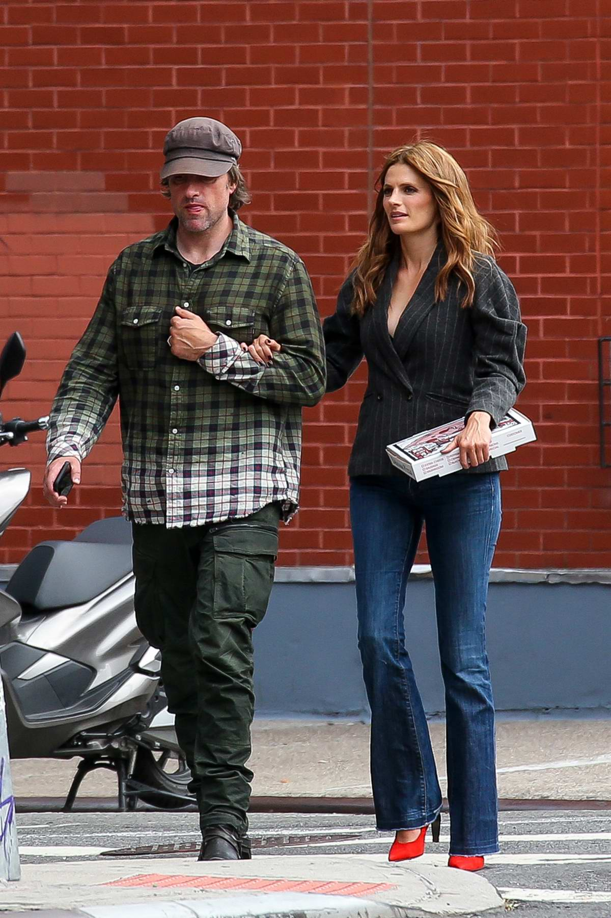 Stana Katic steps out for Pizza with husband Kris Brkljac in New York City