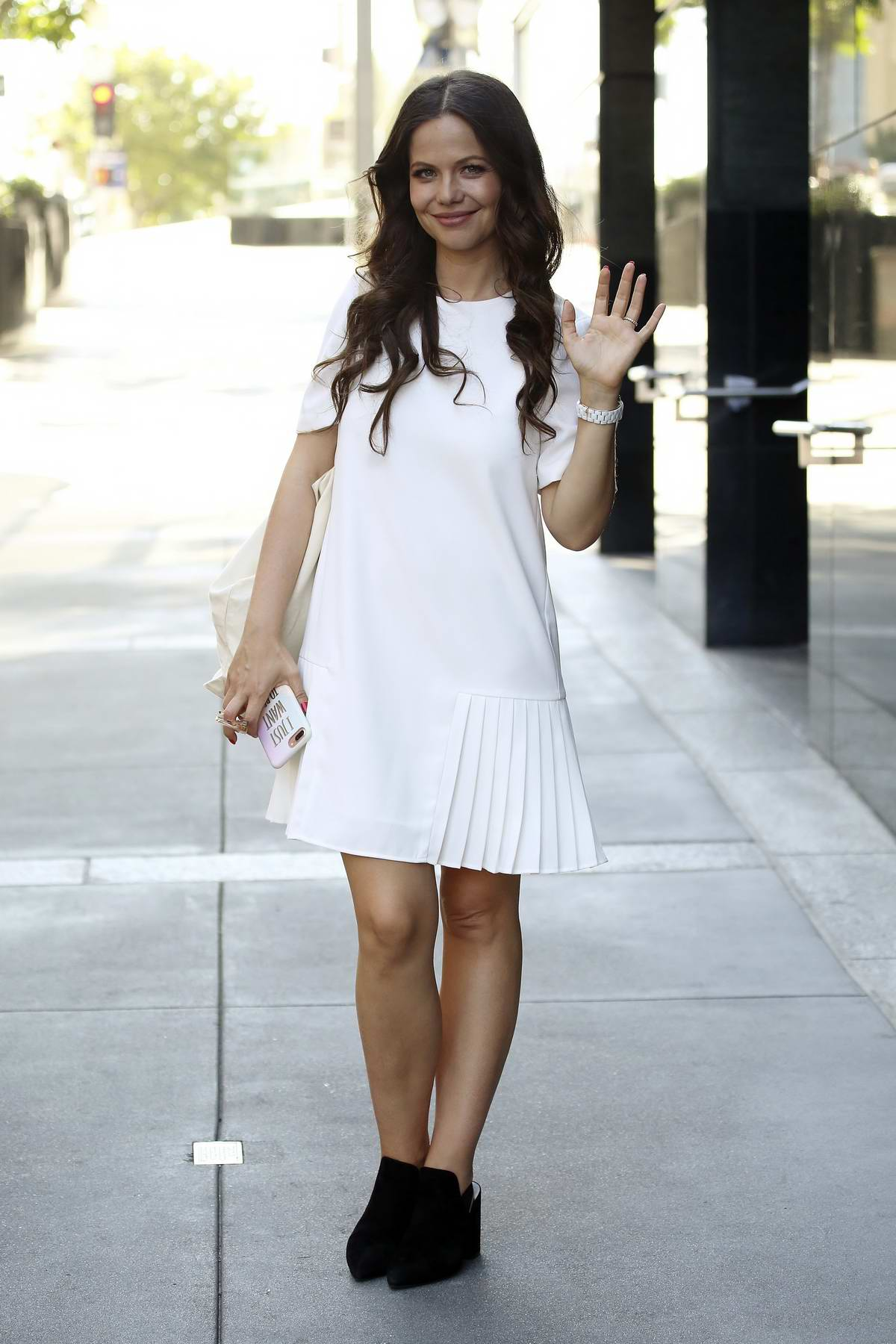 Tammin Sursok is all smiles as she steps out in a white dress while shopping in Los Angeles