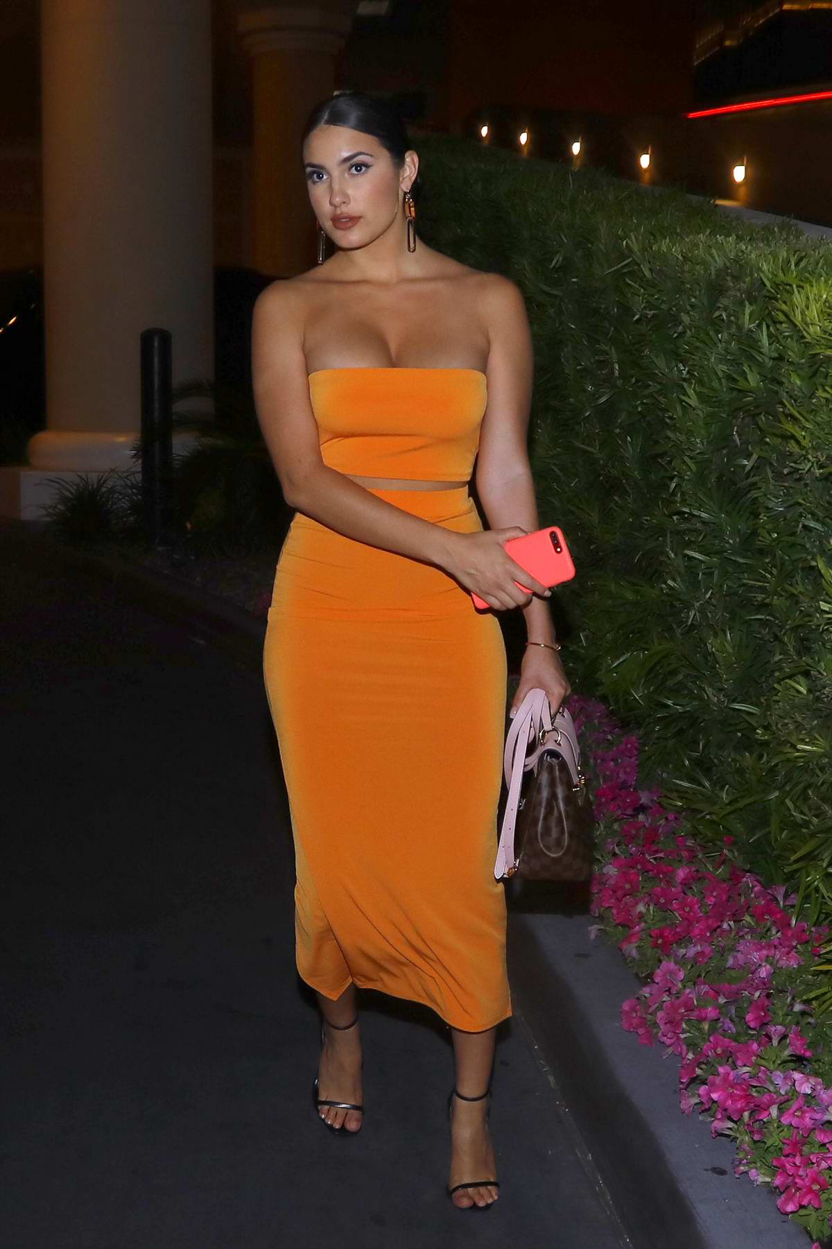 Tao Wickrath looks glamorous in orange as she heads to the Lady Gaga show in Las Vegas, Nevada
