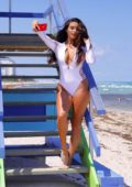 Tao Wickrath stuns in white swimsuit while taking selfies on the beach in Miami, Florida