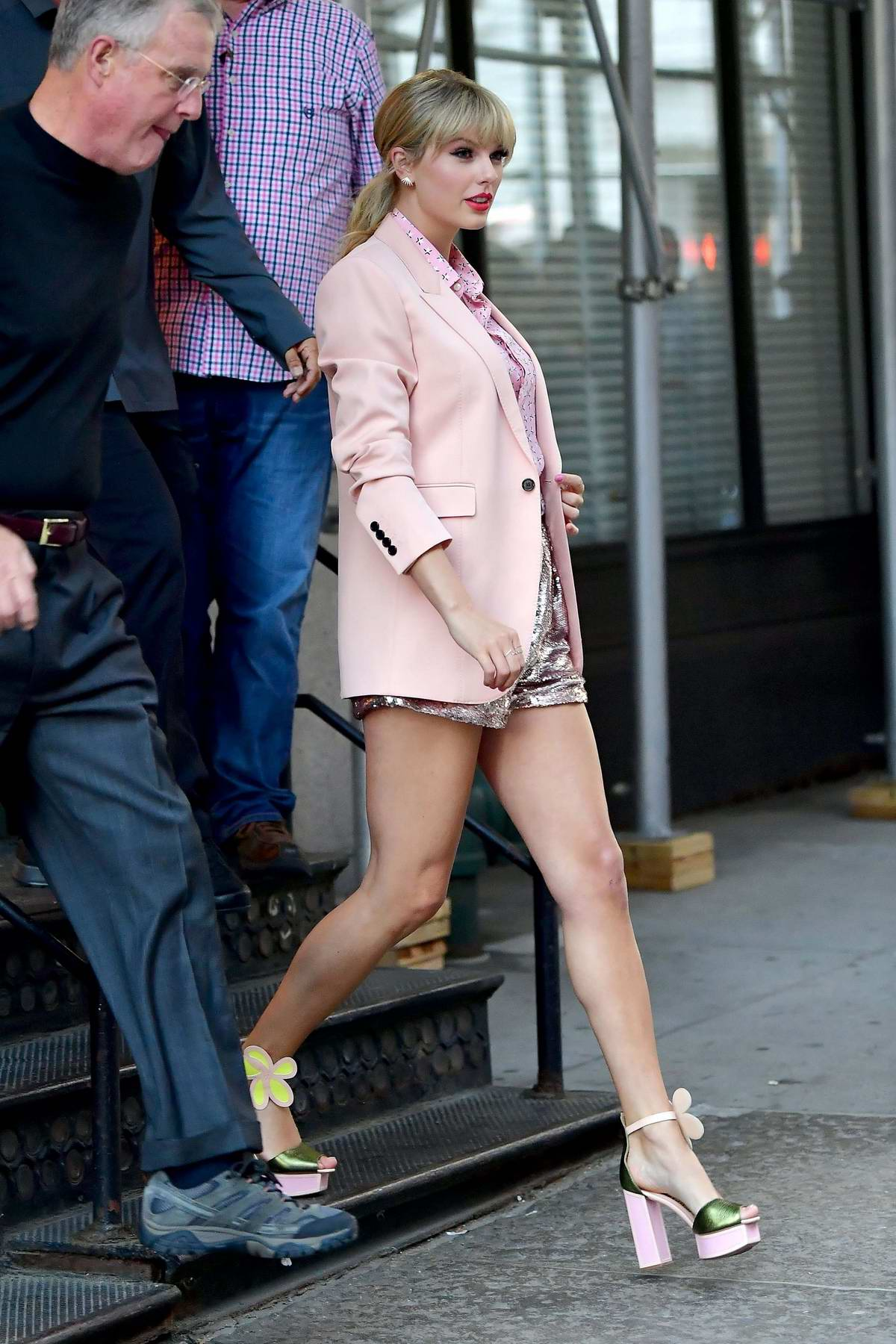 Taylor Swift is pretty in pink as she leaves her apartment in New York City