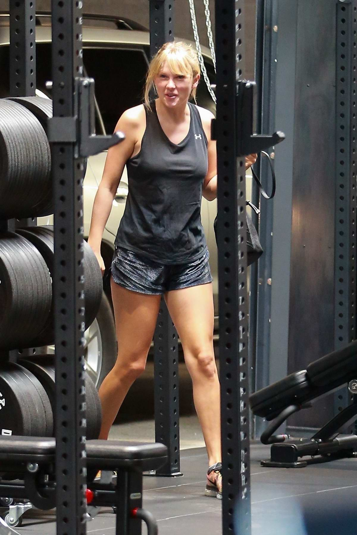 Taylor Swift spotted in black tank top and shorts during a workout session at Dogpound gym in West Hollywood, Los Angeles