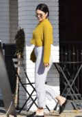Vanessa Hudgens wore cropped mustard sweater and striped pants as she stepped out for coffee with Austin Butler in Studio City, Los Angeles