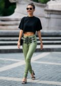 Victoria Justice looks chic in a black crop top and green skintight pants while out in New York City