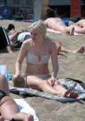 Zara Larsson wears a white bikini while enjoying a beach day with friends in Barcelona, Spain