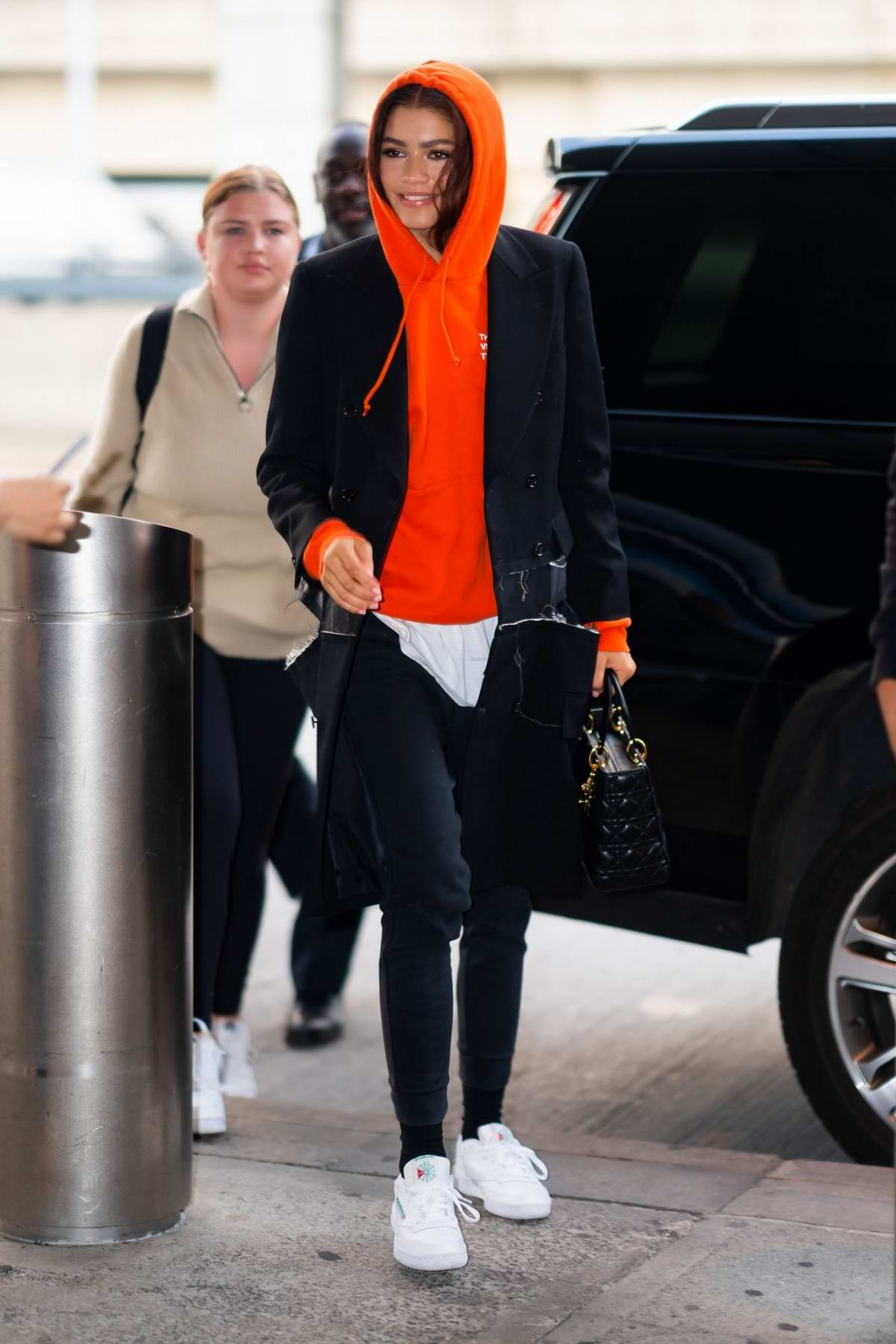 Zendaya arrives in a red hoodie at JFK Airport in New York City