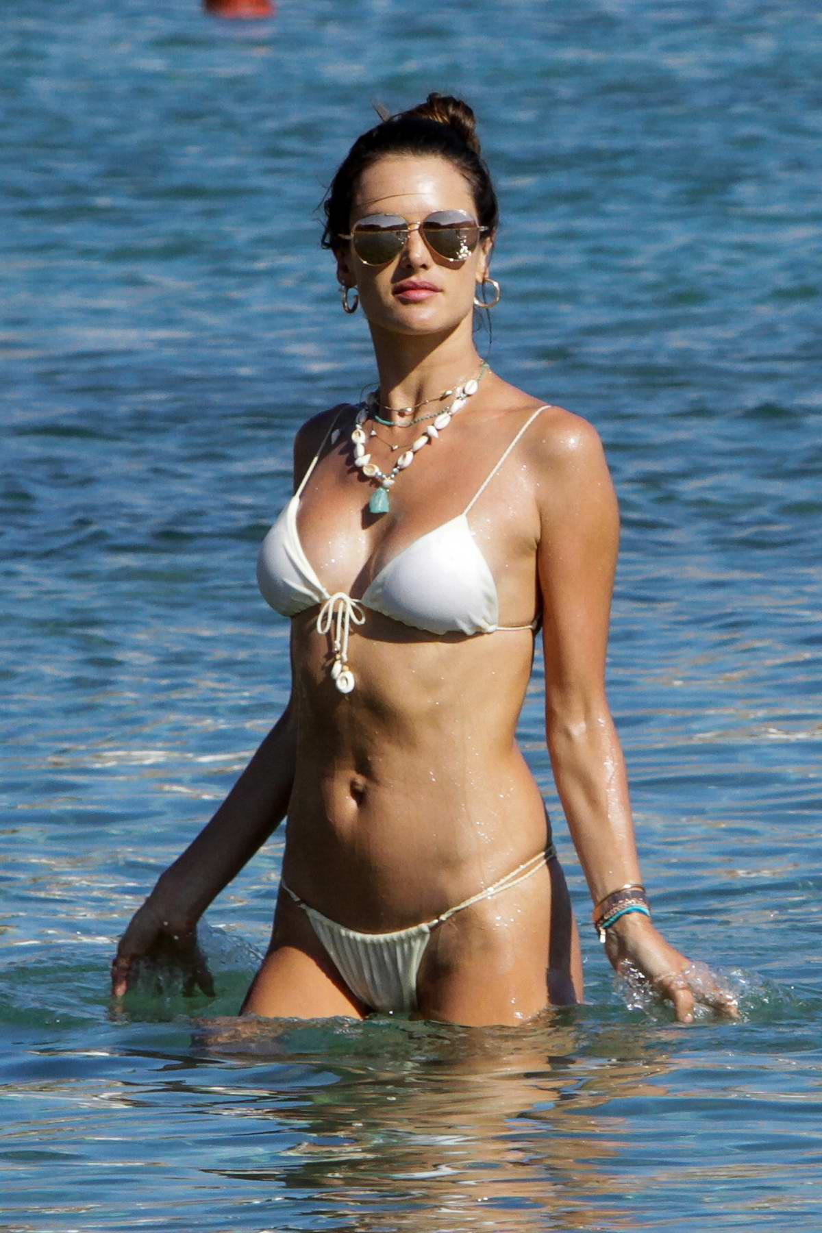 Alessandra Ambrosio looks amazing in a white bikini while enjoying the sun and the beach in Mykonos, Greece