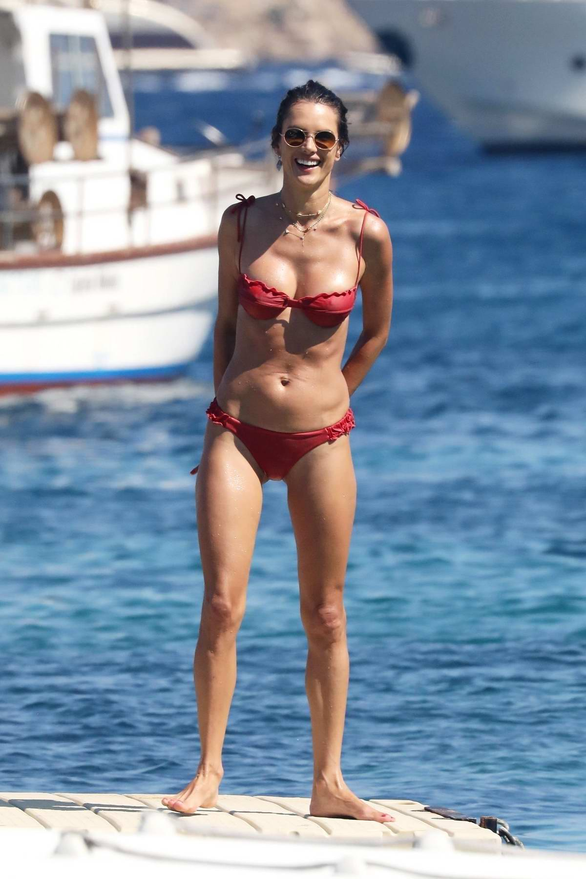 Alessandra Ambrosio rocks a red bikini while relaxing at the beach during her vacation in Mykonos, Greece