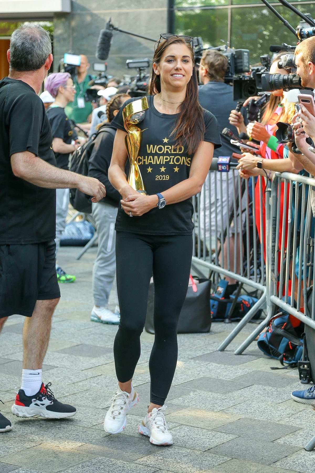 Alex Morgan poses with the 2019 FIFA Women's World Cup trophy in New York City