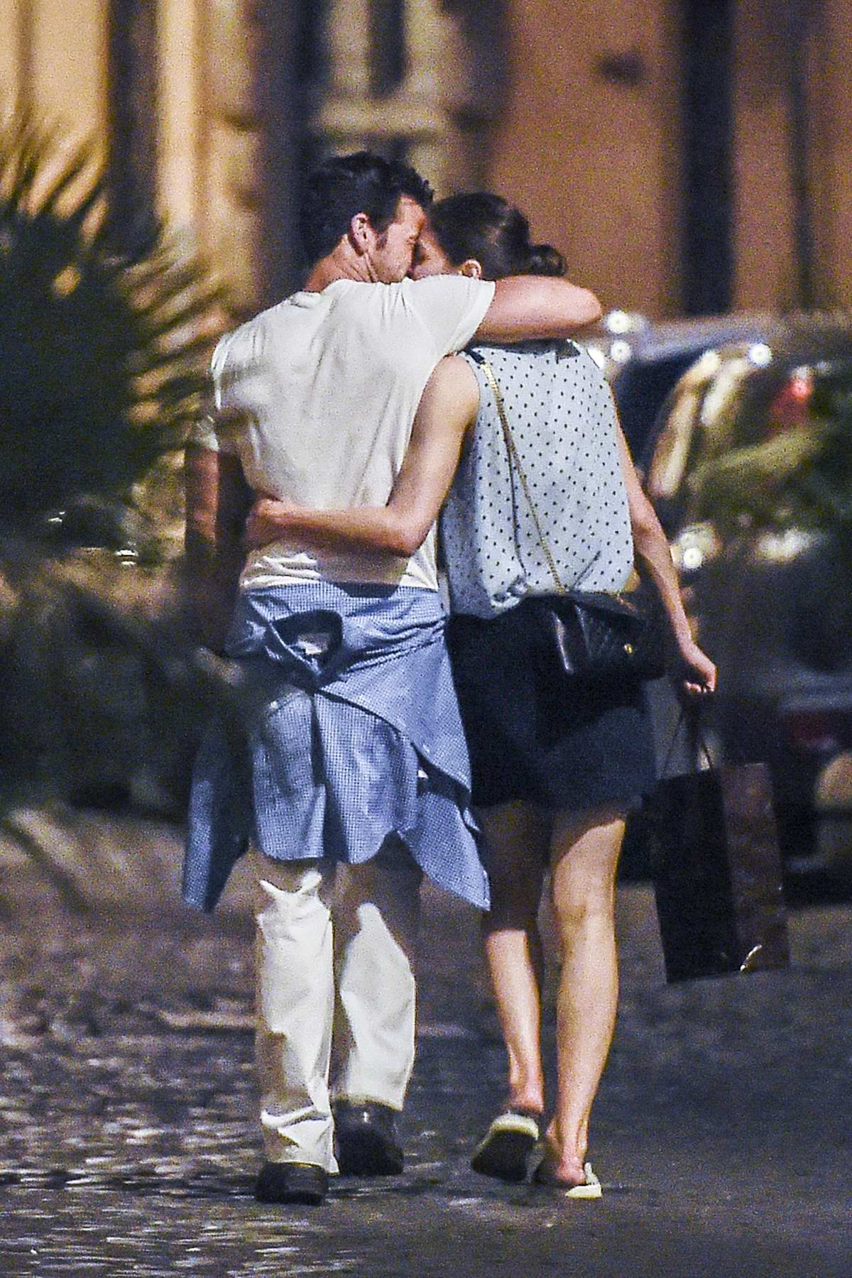 Alexandra Daddario and new boyfriend Brendan Wallace pack on the PDA while enjoying a stroll after dinner in Rome, Italy