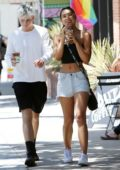 Alexis Ren is all smiles while stepping for coffee in a crop top and denim shorts in Studio City, Los Angeles