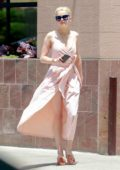 Amber Heard looked radiant in a light pink dress while stopping by a gas station in Los Angeles