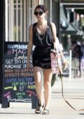 Ana de Armas rocked a black top with matching skirt and sandals as she steps out her dog in Los Angeles