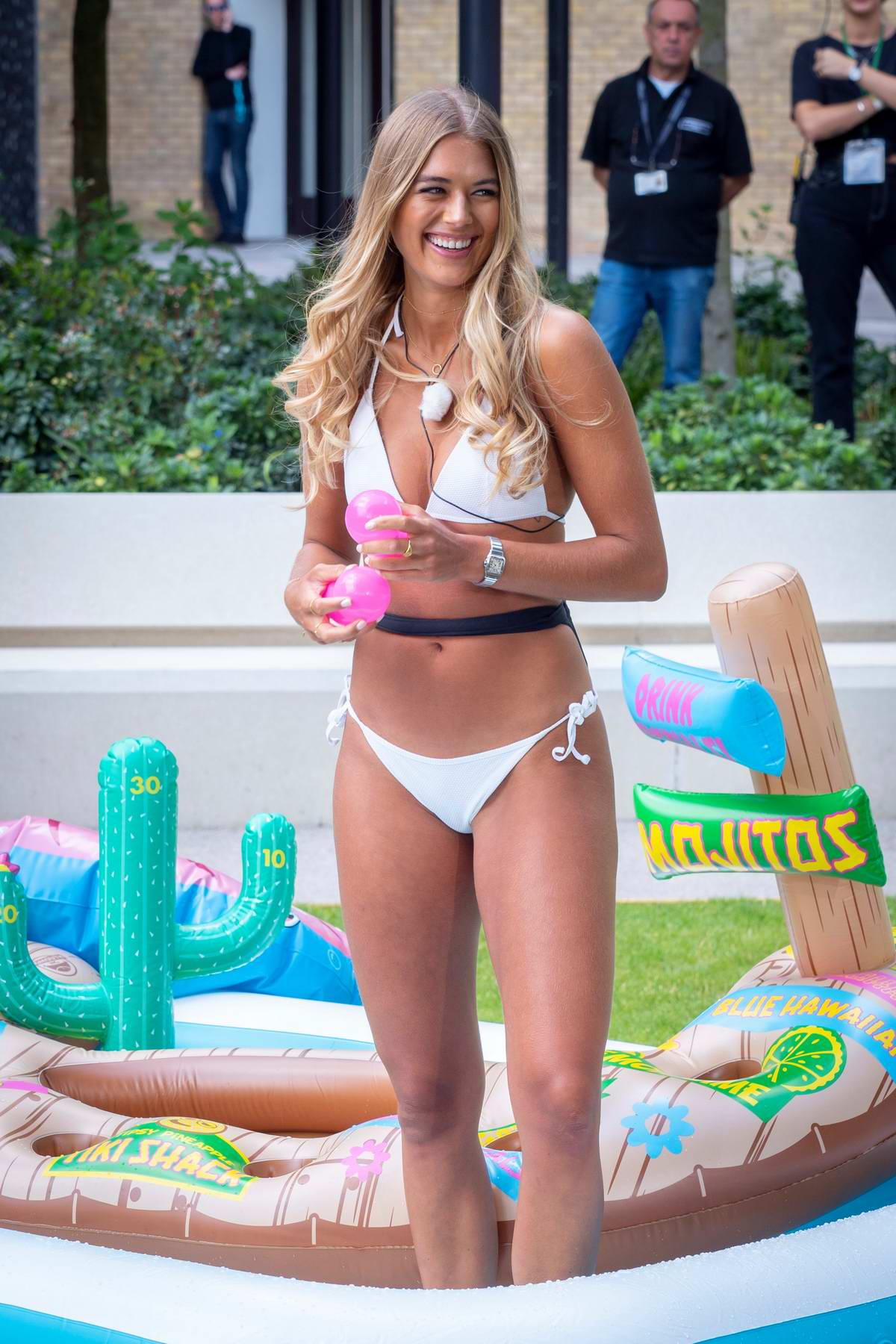 Arabella Chi sports a white bikini during her appearance on 'This Morning' TV show in London, UK