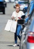 Ariel Winter wears a white crop top and jeans while making a trip to Big Sugar Bakery in Studio City, Los Angeles