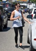 Ashley Greene looks fit in a white tank top and black leggings as she leaves the gym in Studio City, Los Angeles