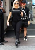 Bebe Rexha rocks a black top with matching leggings and boots while visiting Capital FM studios in London, UK
