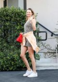 Behati Prinsloo looks great in a leopard print minidress as she leaves Carasoin Day Spa in West Hollywood, Los Angeles