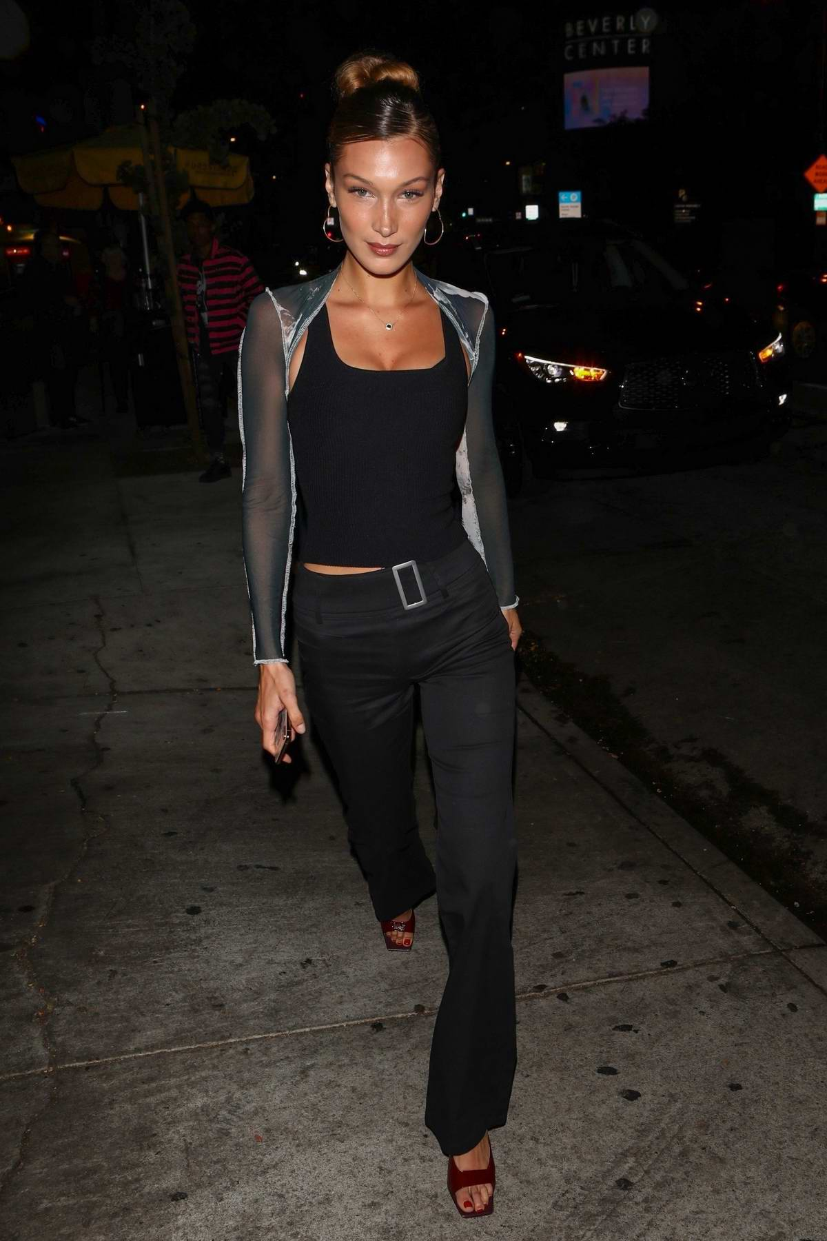 Bella Hadid dons all-black as she arrives for Dave Chappelle's stand up show at the Peppermint Club in West Hollywood, Los Angeles