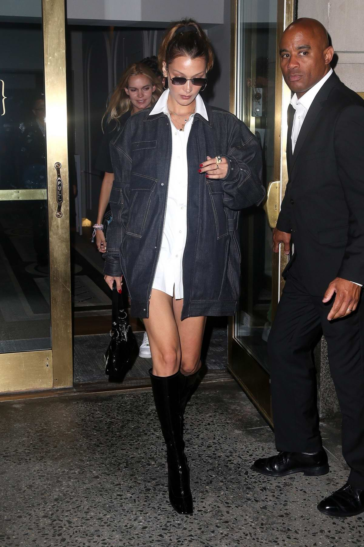 Bella Hadid rocks a denim jacket with knee high boots as she leaves dinner at L'avenue in New York City