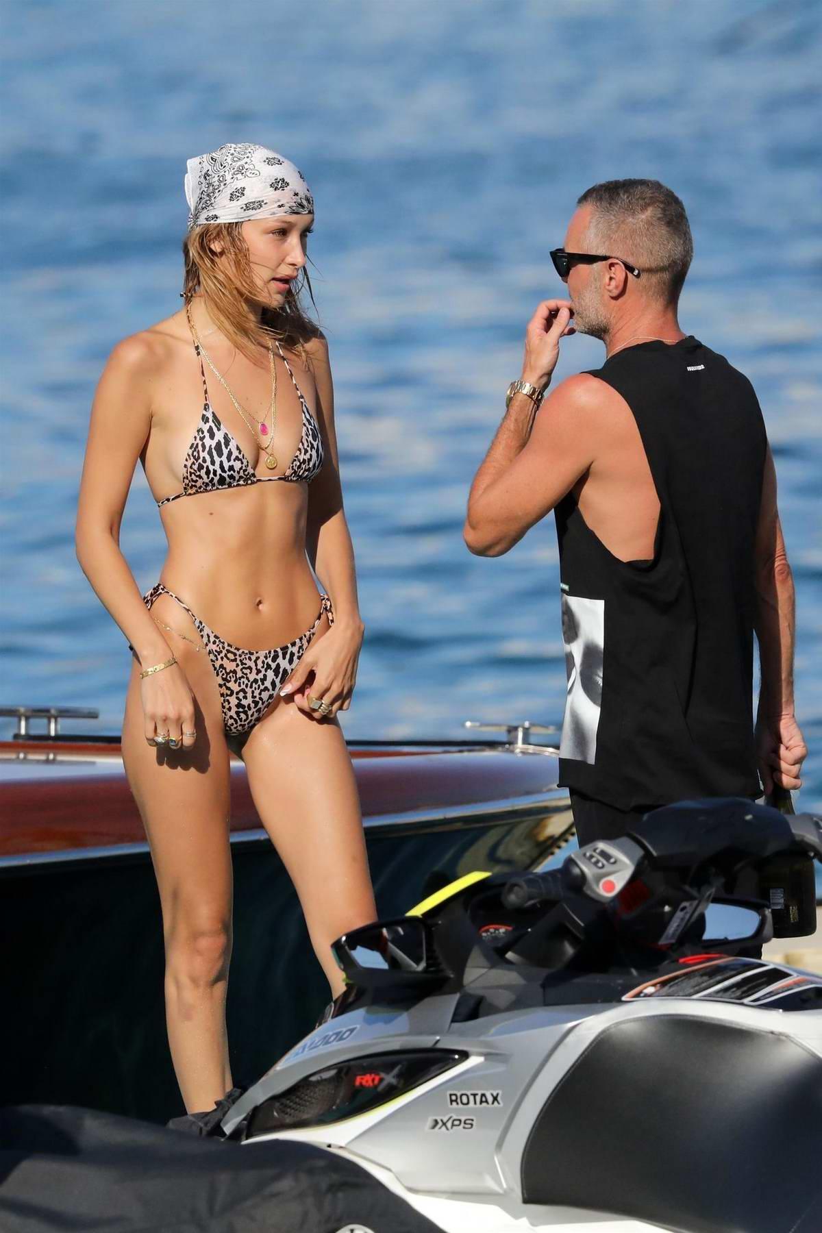 Bella Hadid rocks a leopard print bikini as she rides a jet ski and enjoys the beach in Mykonos, Greece