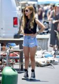 Brenda Song spotted in a black crop top and denim shorts while shopping at a flea market in Los Angeles