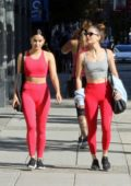 Camila Mendes sports red crop top and leggings as she heads to the gym with Rachel Matthews in Vancouver, Canada