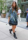 Camila Morrone is all smiles as she steps out in a floral mini dress in New York City