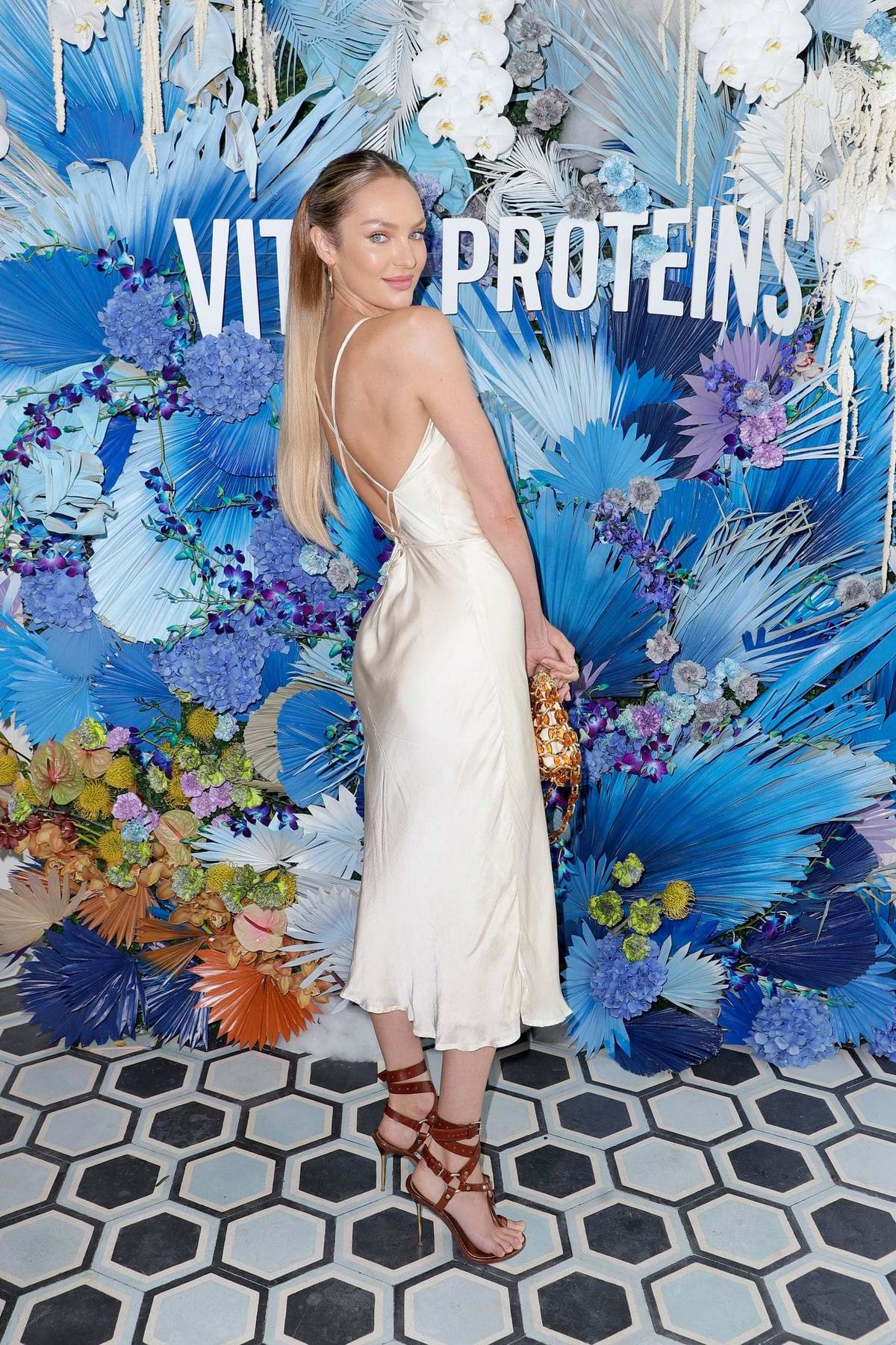 Candice Swanepoel attends the Vital Proteins Swim Week Collagen Water Brunch at Soho Beach House in Miami, Florida
