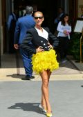 Celine Dion stands out in bright yellow and black ensemble as she leaves Le Crillon restaurant in Paris, France