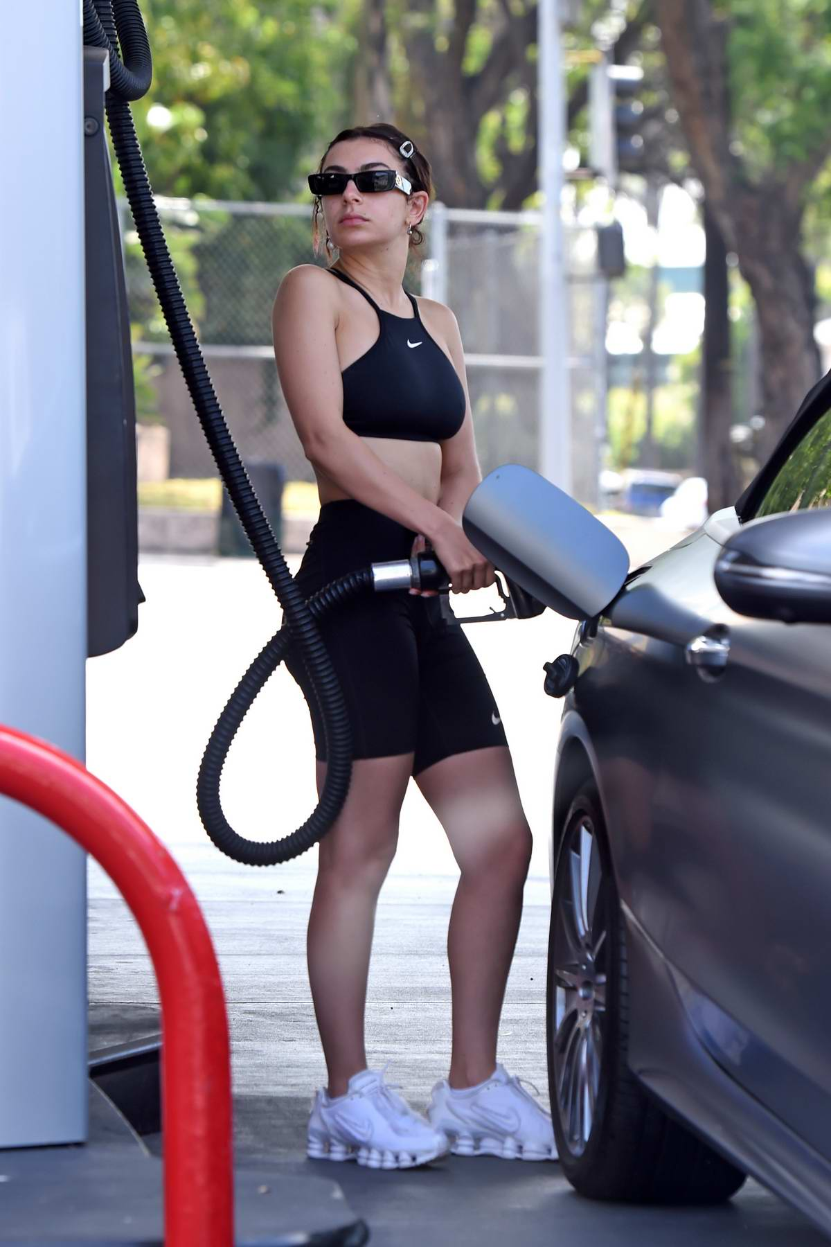 Charli XCX pumps gas after wrapping her workout session in Los Angeles