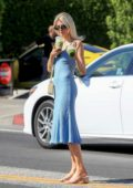Charlotte McKinney looks pretty in a blue dress during a trip to Cha Cha Matcha in West Hollywood, Los Angeles
